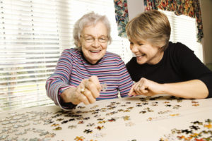 Home Care in West Hollywood_Senior Doing a Puzzle