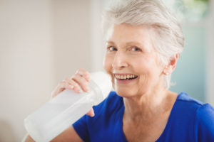 Senior Woman Drinking Water - Los Angeles Home Caregiver Service