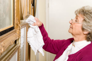 Elderly woman dusting - Senior Care in Los Angeles